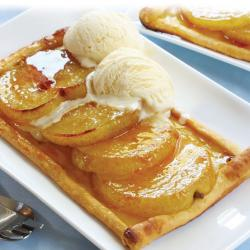 Nashi.pears.on.puff.pastry..with.a.lemon.and.ginger.glaze..topped.with.rich.vanilla.ice.cream