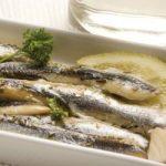 anchovies.in.a.white.plate..Appetizer..Boquerones.en.vinagre.
